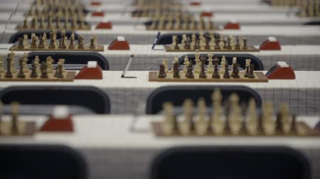 mastermind : Chessboards and figures at chess competition world cadets championship Stock Footage