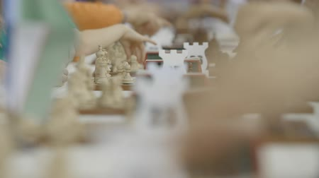 mastermind : Children play chess at world championship with lot of chessboards and clocks Stock Footage