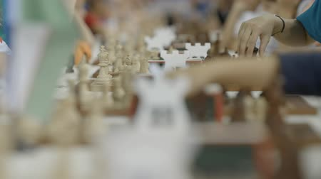 deha : Children play chess at world cadets rapid and blitz championship with lot of chessboards and clocks