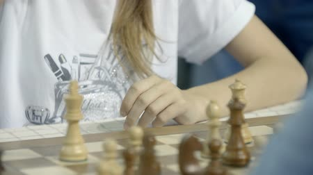 mastermind : Minsk, Belarus - June 25, 2018. World Cadets Chess Championship. Girl play chess Stock Footage