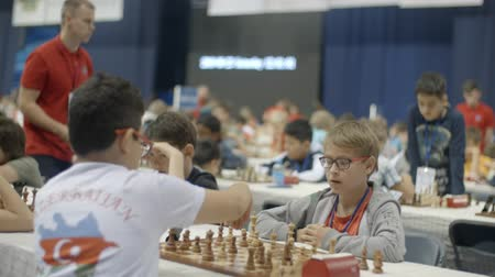 mastermind : Minsk, Belarus - June 22, 2018. Boys play chess World Cadets Chess Championship