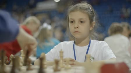 mastermind : Minsk, Belarus - June 22, 2018. Portrait of girl playing chess