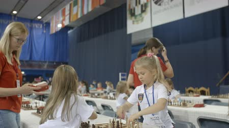 mastermind : Minsk, Belarus - June 22, 2018. Girls play chess at championship