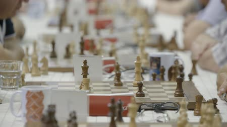 mastermind : Minsk, Belarus - June 25, 2018. Chessboard figures clocks chess competition