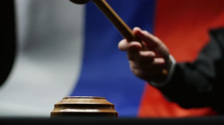 vad : Judge with gavel in his hand hammering against waving Russian flag