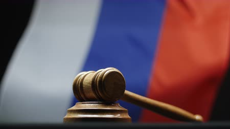 tribunal : Judges wooden gavel Russian flag waving in Russian Federation court room