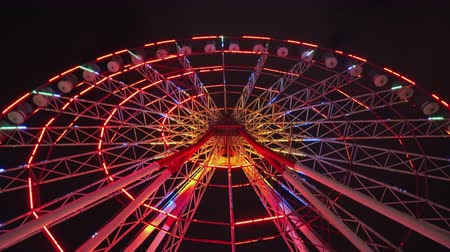 aşağıda : Ferris wheel with colourful illumination carnival spin at amusement park