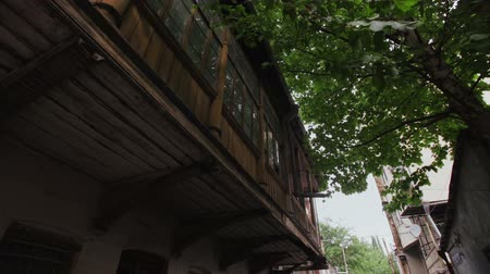 gürcü : Old residential brick work building with a wooden balcony in the old part of Tbilisi, Georgia