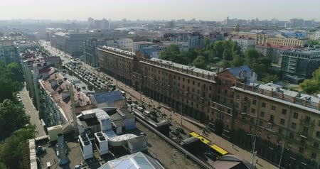 sendika : Early morning in Minsk, Belarus. Aerial drone view of city traffic on the central street, private houses roofs, buildings of Stalinist architecture summer cityscape