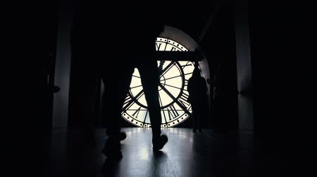 numerais : Silhouettes of people by the big clock in Orsay museum of Paris, France