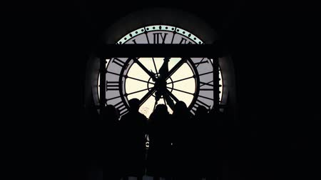 numerais : Silhouettes of people group of tourists by the big clock Orsay museum of Paris Stock Footage