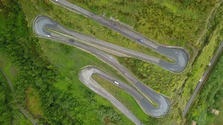 Aerial top down cars driving on serpentine road, drone above mountain road Stock Footage
