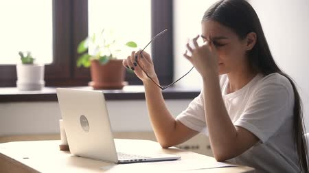human eye : Tired of glasses woman feeling eyestrain using laptop at home office, taking off spectacles, massaging dry red irritated eyes, exhausted lady having eyesight problem after long work study on computer