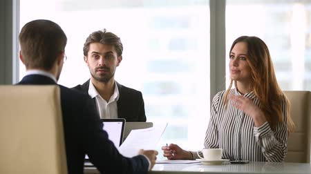 attorney : Business people negotiating under contract at formal group meeting, executives corporate team discussing paperwork with partner making offer convincing consulting clients at negotiations in office
