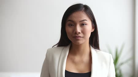 продавщица : Young asian professional businesswoman looking at camera in office, confident millennial office worker in formal wear smiling, chinese staff manager, korean female leader posing for video portrait