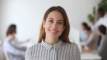 oportunidade : Video portrait of happy female business leader successful millennial businesswoman posing in office with team, smiling professional administrator young executive confident lady boss looking at camera Stock Footage