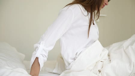 wakeup : Sick woman waking up in bed touching back feeling pain ache discomfort lower lumbar muscular menstrual pain, upset lady having backache problem after sleep on uncomfortable mattress, backpain concept Stock Footage
