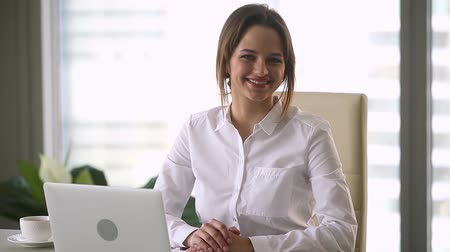 finanziere : Businesswoman successful company owner sitting at desk in modern office pose look at camera feels satisfied, independent skilled financial director or accountant, leader of prosperous business concept Filmati Stock