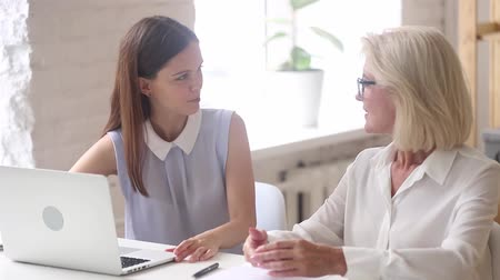 persuasion : Young woman insurance broker financial advisor consulting old female client about services making offer, insurer giving business advice, manager talking to aged employee teaching mentoring at meeting