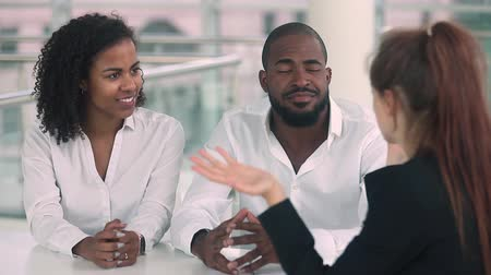 garça real : Young african couple giving high five happy to rent buy new house, black customers first time home buyers owners renters signing mortgage contract handshake realtor receive keys make real estate deal Stock Footage