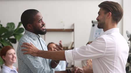 louvor : Happy proud excited african american male employee get rewarded appreciated promoted by executive boss manager motivating shaking hand of successful black office worker as gratitude respect concept.