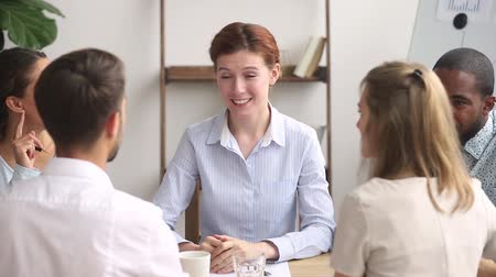 прокат : Happy female boss manager thank male worker finish group meeting, smiling friendly business leader talking make deal with client handshake employee promoting appreciating at diverse team negotiations