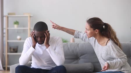 jealous : Frustrated upset african husband tired of annoying angry caucasian wife nagging shouting arguing at home, depressed black guy fed up with toxic jealous girlfriend misunderstanding in bad relationship