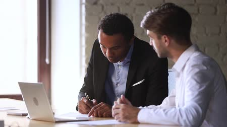 partnerstwo : Happy african american client candidate handshake caucasian manager sign contract at business meeting get hired or buy services take bank loan, black customer and broker dealer shake hands make deal