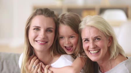 родственники : European family 3 generations mother little daughter aged grandmother portrait, close up faces happy laughing relative people pretty women at home, have fun, spend time together care and love concept