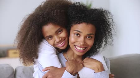 hasonló : Close up natural beauty charming positive faces daughter hug from behind mother relatives look at camera sit on couch, tender moment spiritual intimacy connection, care love, warmth gratitude concept