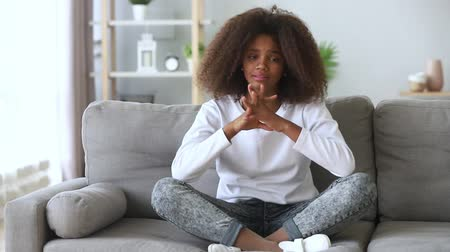 heart failure : Depressed african pre-teen girl sit on couch feels desperate crying, suffers personal problems at school difficult relations with coevals first unrequited love psychological emotional disorder concept Stock Footage