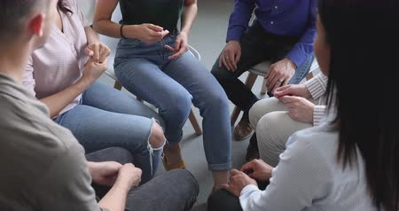 juntar : Diverse people communicate sit in circle at group counseling therapy session concept, multiethnic patients talk share problems get help support at rehab addiction treatment meeting, close up view Vídeos