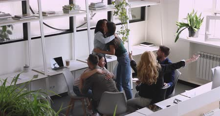 multiethnic : Proud businesswoman leader motivate diverse business team people with great news celebrate corporate victory success unite hug embrace support colleagues thank for help in good teamwork results Stock Footage