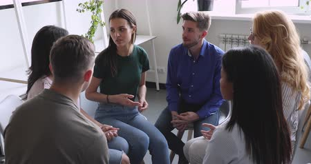 addiction recovery : Multiethnic people group talk sit in circle during group therapy, female psychologist counselor therapist coach listen help patients with problems at psychotherapy session treatment in rehab concept