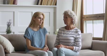compreensão : Understanding worried senior old mother listening stressed honest young adult grown daughter share problem having trust talk with caring elderly mom helping sad woman give advice and support at home. Vídeos