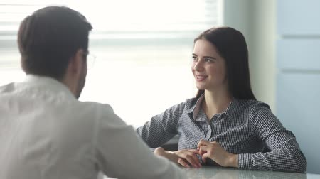 izlenim : Rear view company HR manager interviewing young woman candidate for vacancy sit at desk in office, candidature answering on questions feels confident. Human resources, recruitment, employment concept