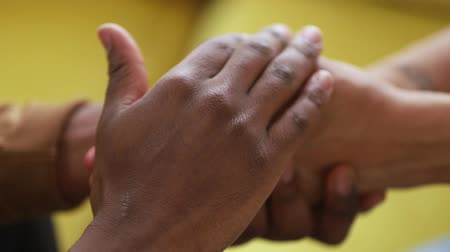 peça : Close up black couple in love holds hands, husband strokes arms beloved wife declares of sincere feelings touch palms say sorry, heart-to-heart talk tender moment share secret strong devotion concept Vídeos