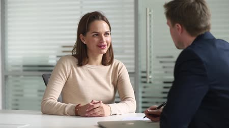 pracodawca : Job interview process focus on smiling attractive european woman applicant answers on questions listening talking with company owner boss in formal suit, good first impressions and employment concept