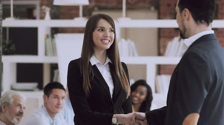 şükran : Staff reward concept, happy female employee get promoted by boss manager handshake praise proud excited businesswoman best worker congratulate with recognition at work thank for team support applause Stok Video
