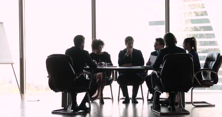 placa : International business people executives staff negotiating sitting at office boardroom table, multi ethnic company team wear suits discussing contract corporate strategy at formal board group meeting Vídeos