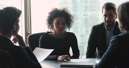 placa : African american female company leader talk at diverse group board meeting, multiethnic team people professional management team and clients discussing contract negotiating at conference office table