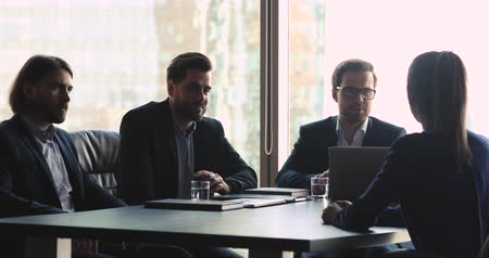decidir : Male hr management employers team of three businessmen talking to female seeker at job interview asking questions making first impression, gender inequality, unequal rights and recruitment concept
