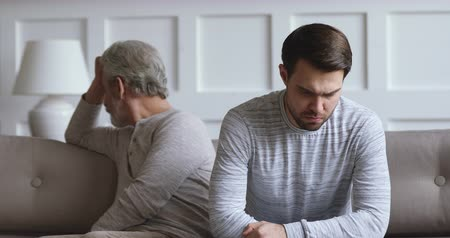 napětí : Angry grown son feel upset after conflict argument with old parent father frustrated ignoring avoiding stubborn elderly dad turn back thinking of different generations problems and conflicts concept Dostupné videozáznamy