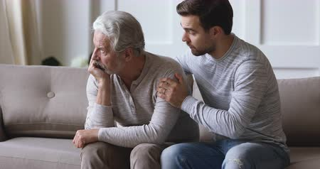 pena : Guilty wrong young adult grown son apologize stubborn upset old senior father say sorry ask for forgiveness regret mistake make peace in difficult two generations age men family relationship concept