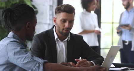 persuasion : Confident male insurer broker bank manager consult african client make business services offer at office meeting, caucasian businessman wear suit sell insurance loan deal benefits talk with customer Stock Footage