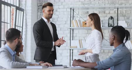 uznání : Proud cheerful female best worker get promoted for professional achievements and skills handshake male boss feel pleased by team feedback applause, employee respect recognition, staff reward concept