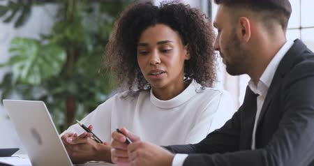 persuasion : African female financial advisor agent lawyer insurer consulting caucasian male client customer explaining insurance contract benefits negotiating discuss agreement at business meeting legal advice