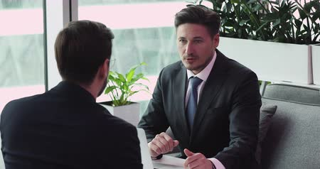 werk zoeken : Happy businessman manager wear suit handshake client business partner at office interview meeting, satisfied employer seller lawyer salesman shake customer hand hire applicant make bank trading deal Stockvideo