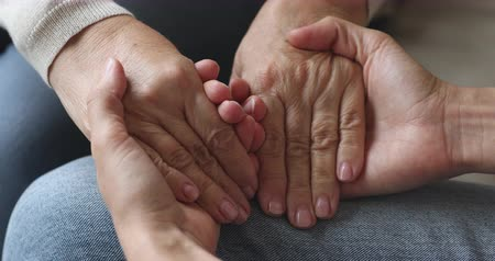 agradecimiento : Young woman hold old female hands giving support concept, kind adult daughter caregiver helping senior mature mother grandparent patient, elder people respect, comfort and care concept, close up view