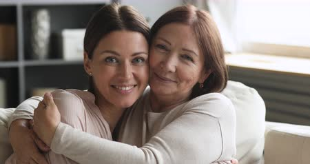 podobný : Loving two generations women family portrait, tender mature older mother and young adult daughter beautiful faces embracing cuddling looking at camera feeling affection enjoy pleasant moment together Dostupné videozáznamy
